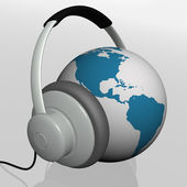 Headset on world globe — 图库照片