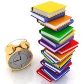 Alarm clock near stack of books — Stock Photo
