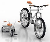 Children's bicycle against a sports bike — Stock Photo