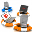 Lifesavers for PC, monitor and laptop — Stock Photo