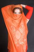 Buikdanseres in het rood — Stockfoto