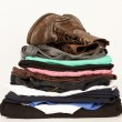 Pile Of Old Clothes And A Pair Of Boots — Stock Photo