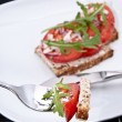 Tomato bread with piece on a fork — Stock Photo