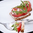 Tomato bread with piece on a fork — Stock Photo #10466379