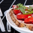 Vegetarian tomato bread with cutlery — Stock Photo