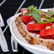 Vegetarian tomato bread with cutlery — Stock Photo #10466393