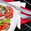 Vegetarian tomato bread with cutlery — Stock Photo #10466403