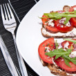 Vegetarian tomato bread with cutlery — Stock Photo #10466404