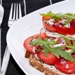 Vegetarian tomato bread with cutlery — Stock Photo #10466406