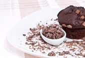 Brown muffin with chocolate on a plate — Stock Photo