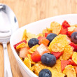 Cornflakes with Strawberries and Blueberries - Stock Photo
