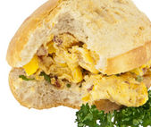 Scrampled eggs on a roll (with clipping path) — Stock Photo
