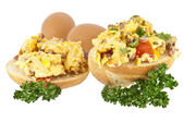 Halved roll with scrambled eggs (with clipping path) — Stock Photo
