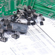 Circuit boards and components with schematics in background — Stock Photo