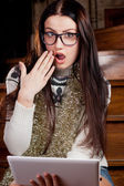 Girl in a glasses with a laptop — Stock Photo