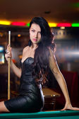 Beautiful girl in the billiard — Stockfoto