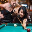 Stock Photo: Two beautiful girls are playing billiards