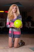 Beautiful girl in bowling — Stock Photo