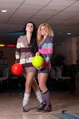 Two beautiful girls in bowling — Stock Photo
