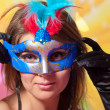 Portrait of young beautiful girl in carnival mask — ストック写真