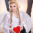 Young beauty girl angel holding the heart — Stock Photo