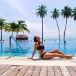 Stock Photo: Woman near pool on tropic island