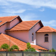 House with tile roof - Stockfoto