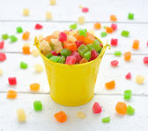 Colorful candied fruits in a small bucket — Stock Photo