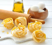 Egg noodles, eggs and olive oil — Stock Photo