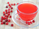 Fresh cranberry juice in a transparent cup — Stock Photo