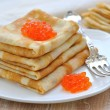 Pancakes with red caviar — Stock Photo
