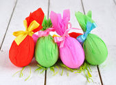 Colorful Easter eggs on a white table — Stock Photo