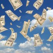 Falling dollars (sky background) - Stock Photo