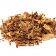 Pile of spilled tobacco (isolated) - Stock Photo