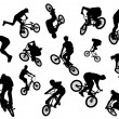 Stock Photo: Black silhouettes of bmx and mtb riders