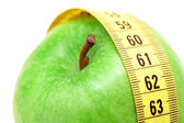 Close up view on apple and measuring tape — Stock Photo