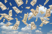 Falling dollars (sky background) — Stock Photo