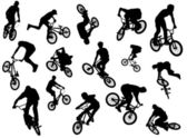 Black silhouettes of bmx and mtb riders — Stock Photo