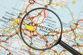 Destination - Amsterdam (magnifying glass) — Stock Photo