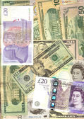 Bunch of U.S. dollars and British pounds — Stock Photo