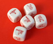 Erotic dices on red background — Stock Photo