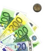 Detail euro notes, and italian coin — Stock Photo