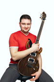 A young man with a guitar — Stock Photo