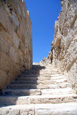 A stone stairway up against the blue sky — Stock Photo
