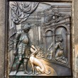 The bas-relief on the Charles Bridge in Prague - Stock Photo