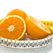Stock Photo: Orange measured by tape meter