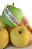 Apples measured by tape meter — Stock Photo
