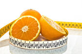 Orange measured by tape meter — Stock Photo