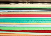Colored cloth lying on the shelf — Stock Photo