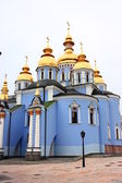 Beautiful blue church domes of gold — Stock Photo